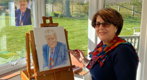 June Schneider Painting a Portrait